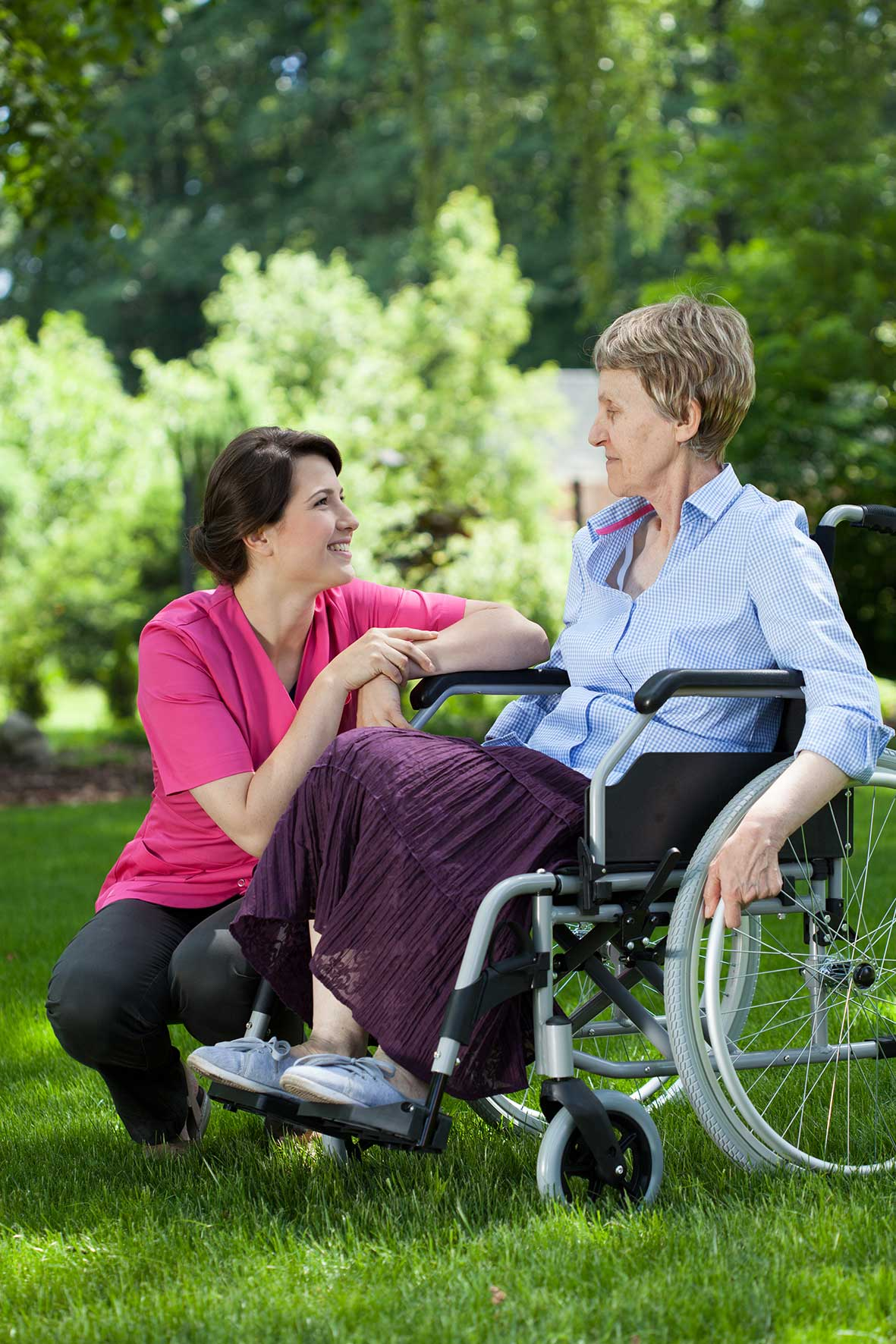 Resident and carer outside